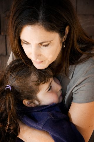 IStock_sad_mother_child5556636S